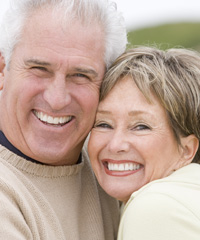 A couple smiling after receiving dental implants at Johnson Family Dental in East Wenatchee, WA